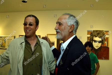Stock Picture of Director Robert Minkoff and Sergio Premoli at an art opening celebrating the works of Sergio Premoli at the Hedi Khorsand Gallery in Los Angeles, CA