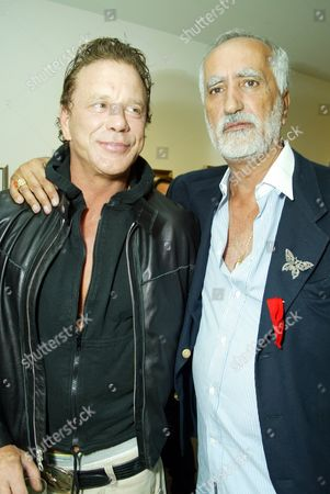 Stock Photo of Actor Mickey Rourke and artist Sergio Premoli at an art opening celebrating the works of Sergio Premoli at the Hedi Khorsand Gallery in Los Angeles, CA