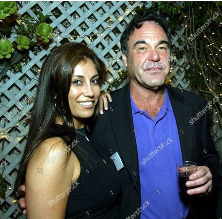 Gallery owner Hedi Khorsand and Oliver Stone at an art opening celebrating the works of Sergio Premoli at the Hedi Khorsand Gallery in Los Angeles, CA