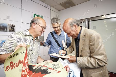 Richard Lester signs ephemera for fans before the screening