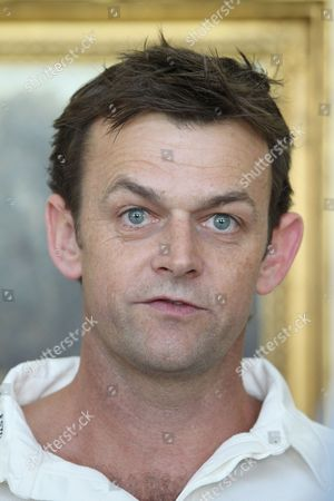Adam Gilchrist of Australia and the Rest of the World XI.