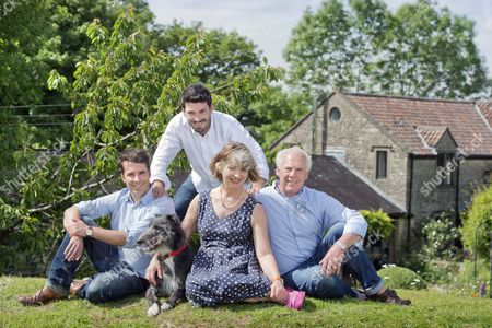 Tom Herbert and Henry Herbert with parents Polly and Trevor at home in Little Sodbury