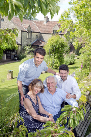 Stock Photo of Tom Herbert and Henry Herbert with parents Polly and Trevor at home in Little Sodbury