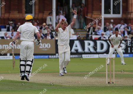 MCC'S Brett Lee (Australia) celebrates the catch of Rest of the World Paul Collingwood (England) caught by MCC'S Rahul Dravid (India)