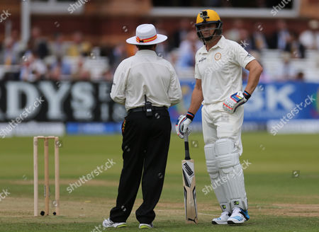 Rest of the World Adam Gilchrist (Australia) with GOPRO Camera on his helmet