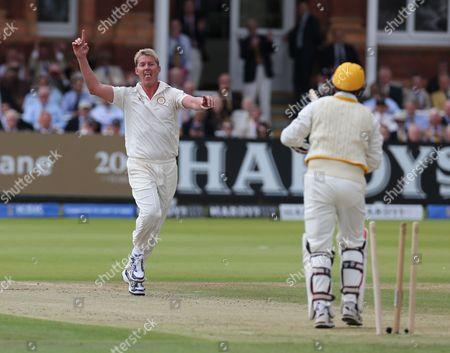 MCC'S Brett Lee (Australia) celebrates the wicket of Rest of the World Virender Sehwag (India)