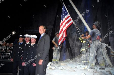 GEORGE E PATAKI WITH THE FIREFIGHTERS GEORGE JOHNSON, DAN MCWILLIAMS AND BILL EISENGREIN