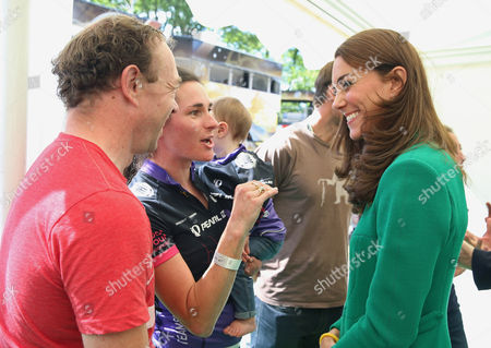 Catherine Duchess of Cambridge chats to Sarah Storey, her husband Barney and daughter Louise (aged 1) at the finish line of Stage 1