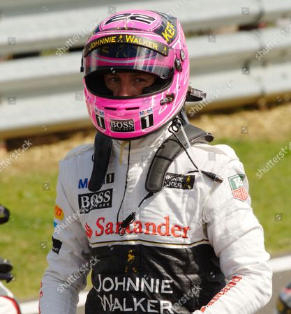 Jenson Button wearing his special pink helmet in tribute to his father John Button