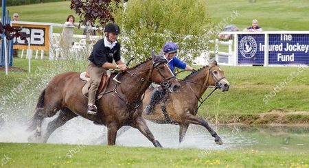 John Francombe and Zara Tindall riding through the water in the JCB Challenge