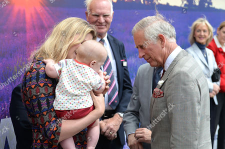 Prince Charles meets Emylia Hall, 35, from Bristol, along with her son Calvin Jack, 5 months, during a visit to Castle Cary Railway Station