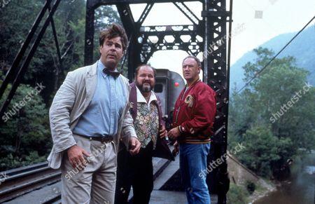 FILM STILLS OF 'LOOSE CANNONS' WITH 1990, DAN AYKROYD, BRIDGE, BOB CLARK, DOM DeLUISE, EXTERIOR, LAURENCE HARVEY, TRAIN, TREES IN 1990