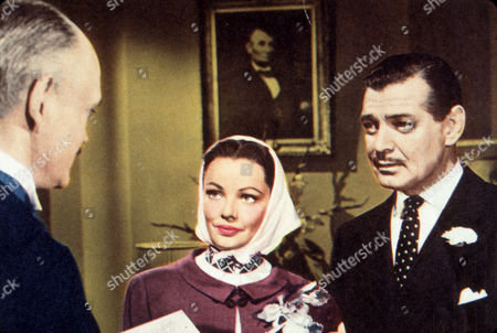 FILM STILLS OF 'NEVER LET ME GO' WITH 1953, CLOTHING, DELMER DAVES, CLARK GABLE, GETTING MARRIED, HAT, HEADSCARF, SUIT, GENE TIERNEY IN 1953