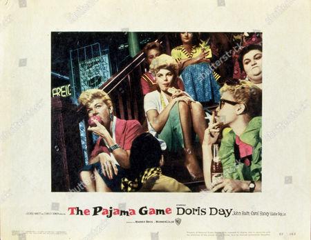 FILM STILLS OF 'PAJAMA GAME' WITH 1957, DORIS DAY, STANLEY DONEN, EATING, GROUP, BARBARA NICHOLS, SMOKING, STAIRCASE IN 1957