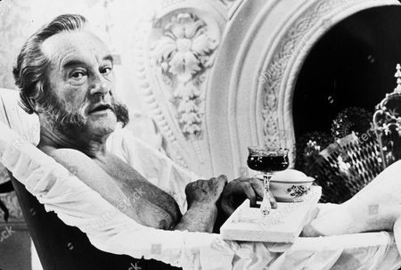 FILM STILLS OF 'BEST HOUSE IN LONDON' WITH 1969, BARE CHEST, BATH ROOM, BATH TUBS/SHOWERS, DRINKING, FIREPLACE/MANTLE, GEORGE SANDERS, WINE IN 1969