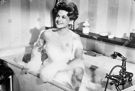 FILM STILLS OF 'WHY BOTHER TO KNOCK' WITH 1965, BARE SHOULDERS, BATH TUBS/SHOWERS, BATHING, BATHTUB, NICOLE MAUREY, BUBBLE BATH IN 1965