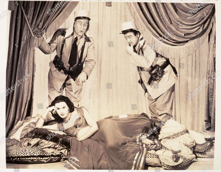 FILM STILLS OF 'ABBOTT AND COSTELLO IN THE FOREIGN LEGION' WITH 1950, BUD ABBOTT, CLOTHING, COMEDY (SLAPSTICK), COMEDY TEAM, LOU COSTELLO, FOREIGN LEGION (COMEDY), FOREIGN LEGION UNIFORM, CHARLES LAMONT, PATRICIA MEDINA IN 1950