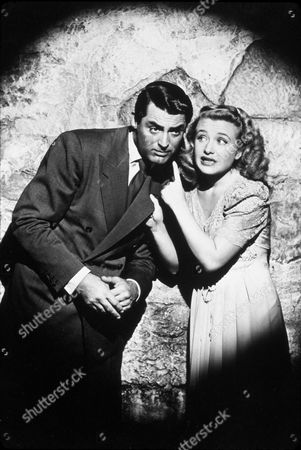 FILM STILLS OF 'ARSENIC AND OLD LACE' WITH 1944, CARY GRANT, PRISCILLA LANE, AFRAID, HYSTERICAL, DRAMA QUEEN, LISTENING, SECRET, DESPERATE, SPOTLIGHT, HAIR - SLICK, MURDER IN 1944