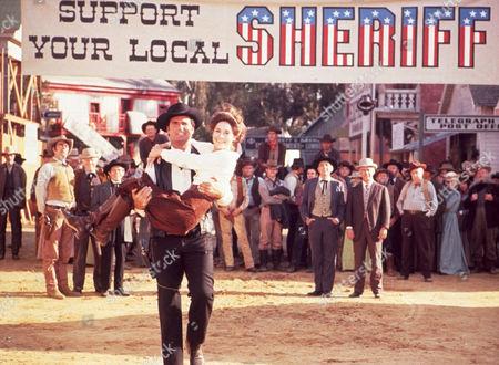 FILM STILLS OF 'SUPPORT YOUR LOCAL SHERIFF' WITH 1969, JAMES GARNER, JOAN HACKETT, BURT KENNEDY IN 1969