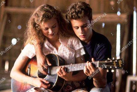 FILM STILLS OF 'SHOUT' WITH 1991, HEATHER GRAHAM, GUITAR, JEFFREY HORNADAY, MUSICAL INSTRUMENT, JAMES WALTERS IN 1991