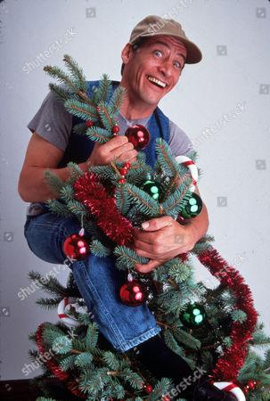 FILM STILLS OF 'ERNEST SAVES CHRISTMAS' WITH 1988, JOHN CHERRY, CHRISTMAS, JIM VARNEY IN 1988