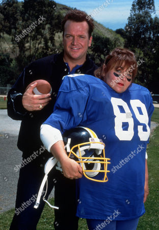 FILM STILLS OF 'BACKFIELD IN MOTION - TV' WITH 1991, TOM ARNOLD, ROSEANNE BARR IN 1991
