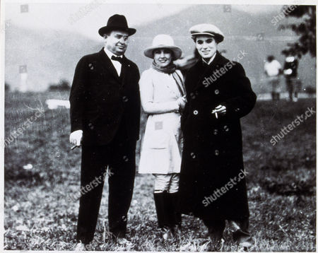 Stock Picture of FILM STILLS OF 1920, CHARLES CHAPLIN, EDNA PURVIANCE, J D WILLIAMS, CHARLIE CHAPLIN IN 1920