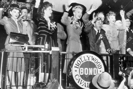Stock Photo of FILM STILLS OF 1943, FRED ASTAIRE, LUCILLE BALL, ENSEMBLE, JUDY GARLAND, GREER GARSON, BETTY HUTTON, KAY KYSER, HARPO MARX, MICKEY ROONEY, WAR BOND RALLY IN 1943