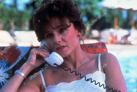 FILM STILLS OF 'BLAME IT ON RIO' WITH 1984, STANLEY DONEN, VALERIE HARPER, TELEPHONING IN 1984