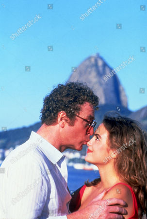 FILM STILLS OF 'BLAME IT ON RIO' WITH 1984, MICHAEL CAINE, STANLEY DONEN, MICHELLE JOHNSON IN 1984