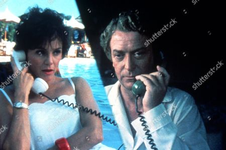 FILM STILLS OF 'BLAME IT ON RIO' WITH 1984, MICHAEL CAINE, STANLEY DONEN, VALERIE HARPER, TELEPHONING IN 1984