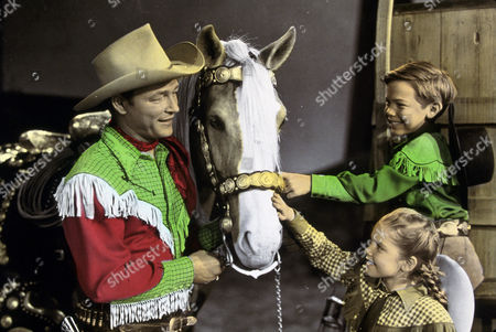 FILM STILLS OF 'MELODY TIME' WITH 1948, BOBBY DRISCOLL, LUANA PATTEN, ROY ROGERS IN 1948