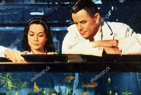 FILM STILLS OF 'FATE IS THE HUNTER' WITH 1964, GLENN FORD, NANCY KWAN, RALPH NELSON IN 1964