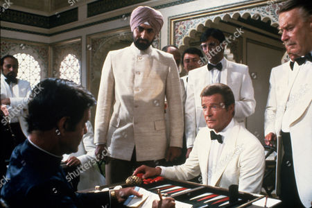 FILM STILLS OF 'OCTOPUSSY' WITH 1983, KABIR BEDI, JOHN GLEN, JAMES BOND, LOUIS JOURDAN, ROGER MOORE IN 1983