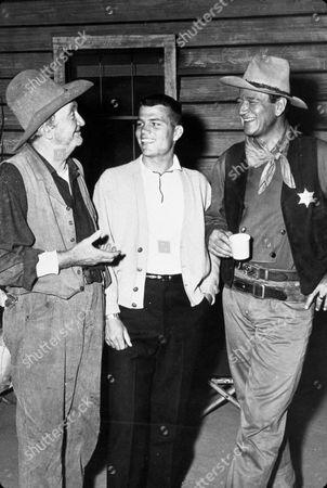 FILM STILLS OF 'RIO BRAVO' WITH 1959, WALTER BRENNAN, HOWARD HAWKS, JOHN WAYNE, PATRICK WAYNE IN 1959