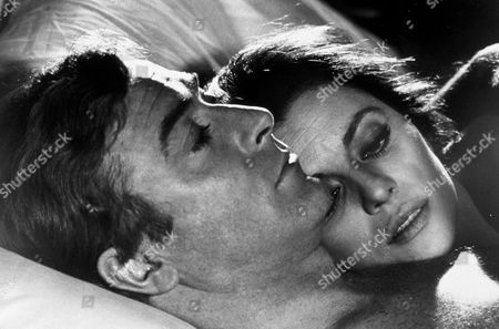 FILM STILLS OF 'DEADFALL' WITH 1968, BED (IN/ON), MICHAEL CAINE, BRYAN FORBES, GIOVANNA RALLI IN 1968