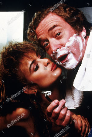 FILM STILLS OF 'BLAME IT ON RIO' WITH 1984, MICHAEL CAINE, STANLEY DONEN, MICHELLE JOHNSON, SHAVING IN 1984