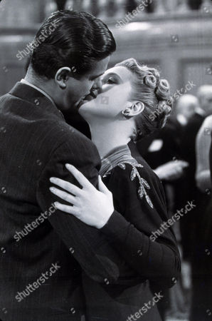 FILM STILLS OF 'SABOTEUR' WITH 1942, ROBERT CUMMINGS, ALFRED HITCHCOCK, KISSING, PRISCILLA LANE, ROMANCE IN 1942
