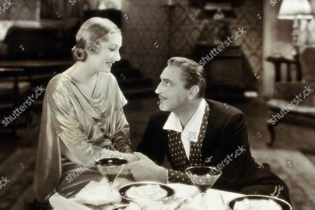 FILM STILLS OF 'ARSENE LUPIN' WITH 1932, JOHN BARRYMORE, JACK CONWAY, DINING, KAREN MORLEY IN 1932