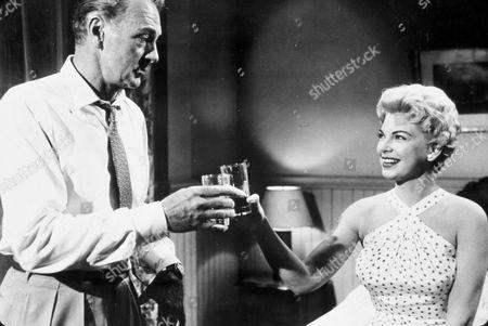 FILM STILLS OF 'TEN NORTH FREDERICK' WITH 1958, GARY COOPER, PHILIP DUNNE, BARBARA NICHOLS, TOASTING DRINKS IN 1958