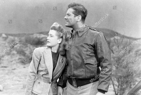 FILM STILLS OF 'SABOTEUR' WITH 1942, ROBERT CUMMINGS, ALFRED HITCHCOCK, PRISCILLA LANE IN 1942