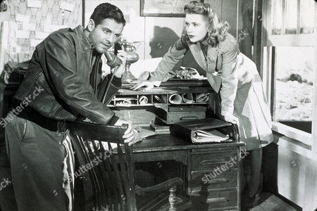 FILM STILLS OF 'SABOTEUR' WITH 1942, ROBERT CUMMINGS, ALFRED HITCHCOCK, PRISCILLA LANE, TELEPHONING IN 1942