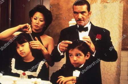 Stock Image of FILM STILLS OF 'FOUR ROOMS' WITH 1995, ANTONIO BANDERAS, LANA McKISSACK, QUENTIN TARANTINO, TAMLYN TOMITA, DANNY VERDUZCO IN 1995