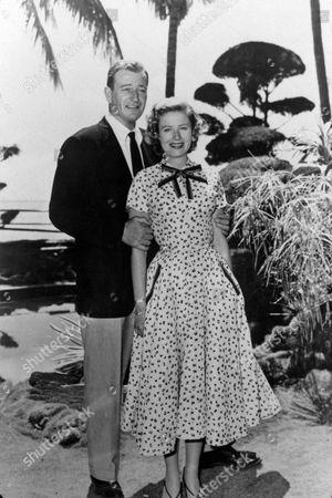 FILM STILLS OF 'BIG JIM McLAIN' WITH 1952, EDWARD LUDWIG, NANCY OLSON, JOHN WAYNE IN 1952