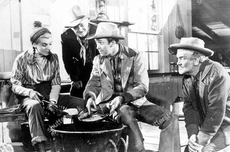 FILM STILLS OF 'FAR COUNTRY' WITH 1955, WALTER BRENNAN, CORINNE CALVET, JAY C FLIPPEN, ANTHONY MANN, JAMES STEWART IN 1955