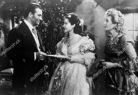 FILM STILLS OF 'IN OLD OKLAHOMA' WITH 1943, BINNIE BARNES, WILLIAM McGANN, HELEN PARRISH, JOHN WAYNE IN 1943