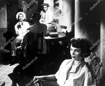 FILM STILLS OF 'WE WERE STRANGERS' WITH 1949, JOHN HUSTON, JENNIFER JONES, GILBERT ROLAND IN 1949