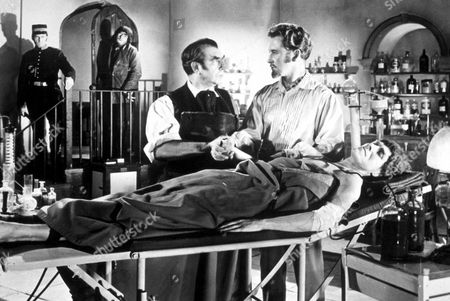 FILM STILLS OF 'BLOOD OF THE VAMPIRE' WITH 1958, VINCENT BALL, HENRY CASS, DONALD WOLFIT IN 1958