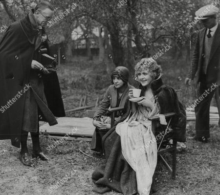 Ernest Thesiger Photographing Actress Betty Balfour During A Wait In The Filming Of 'the Vagabond Queen'.