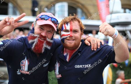 Crew members of Great Britain Ollie Phillips and James Carter celebrate their second place at the Clipper Round the World Race as they return to St Katherine Docks after eleven months of journey